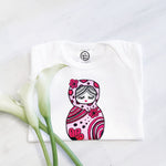 pink and red russian nesting doll retro toy print on organic cotton baby girl onesie toddler shirt