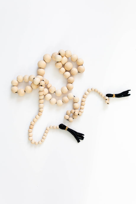 becky pollard, seven sixteen, wooden garland, wood bead garland, coffee table beads, decorative beads, leather, leather tassel, coffee table accessory