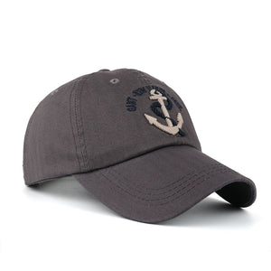 dark gray anchor baseball hat with tan logo by anchor in waves
