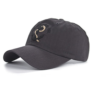 side front video of dark gray mens anchor baseball hat by anchor in waves