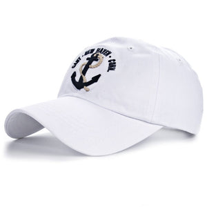 Mens white anchor baseball hat with blue logo by anchor in waves