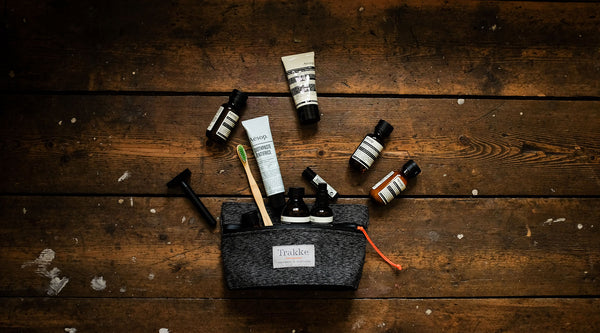 an image showing what to pack in a dopp kit.