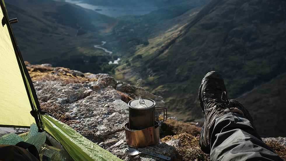 An open tent and coffee stove on a peak of the Three Sisters in Glencoe