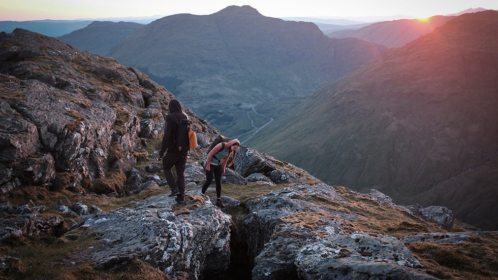 A man and a woman search for a place to sleep on top of Arrochar