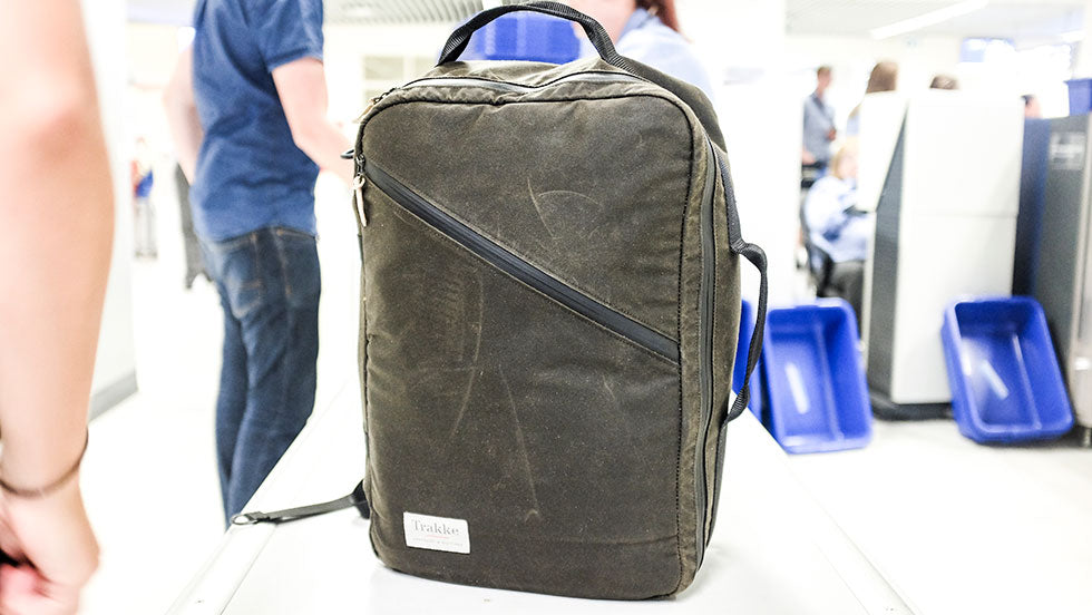 Storr carry on handluggage backpack sits on a conveyer belt in airport security