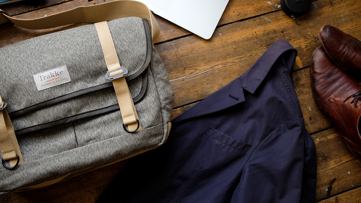 a work messenger bag with a few items from our business travel packing list
