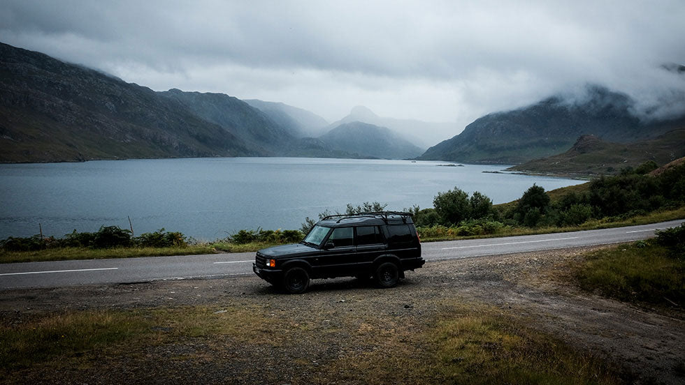 A black land rover is stopped at the side of the road during the North Coast 500 drive
