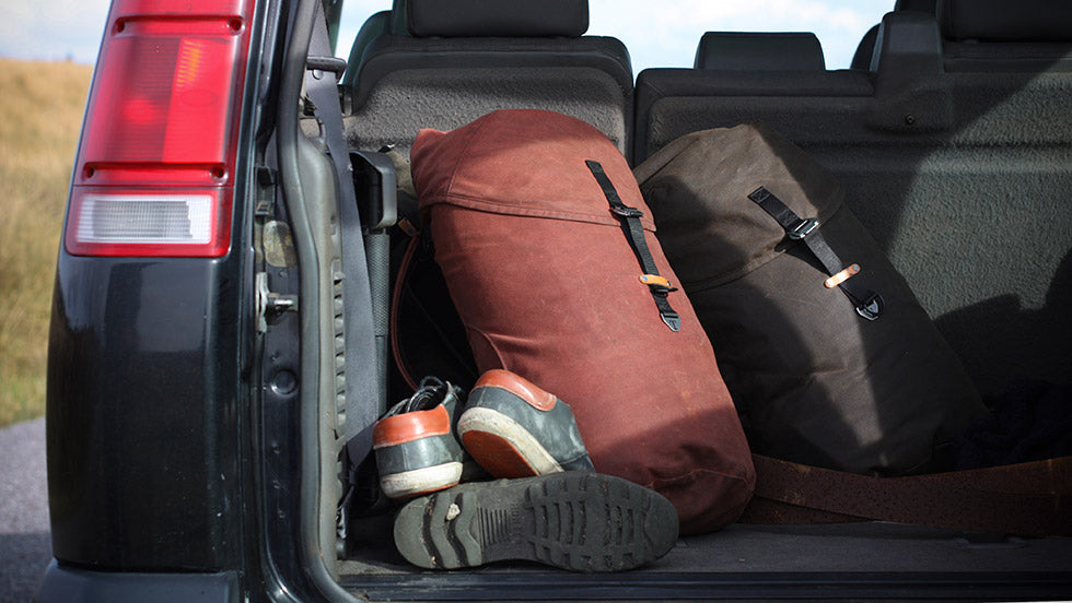 An older design of Trakke bag in the boot of a car on the isle of jura