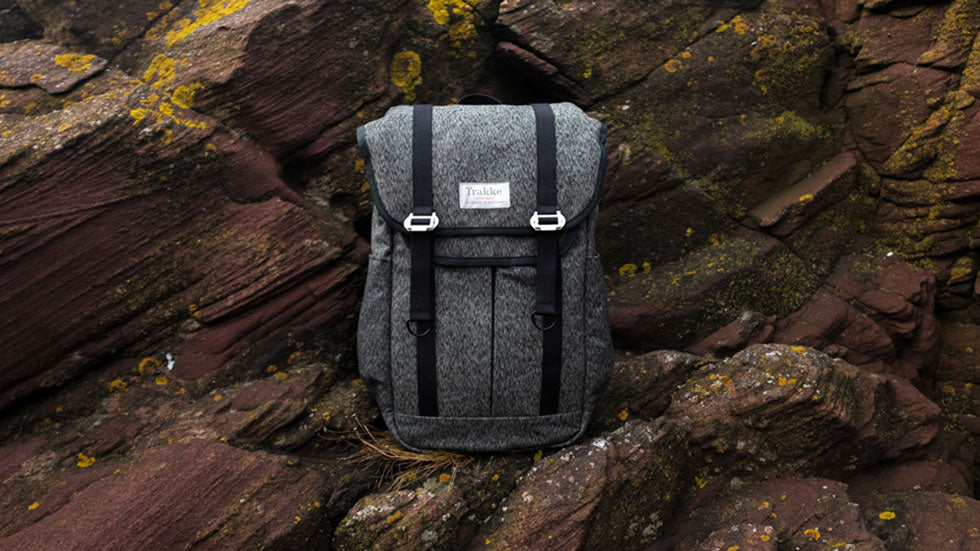 The Bannoch backpack sits on a rock formation in Arbroath sea cliffs, Scotland.