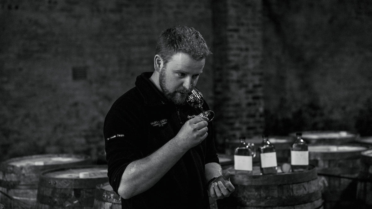Adam Hannett Master Distiller of Bruichladdich takes in the expression of a glass of whisky