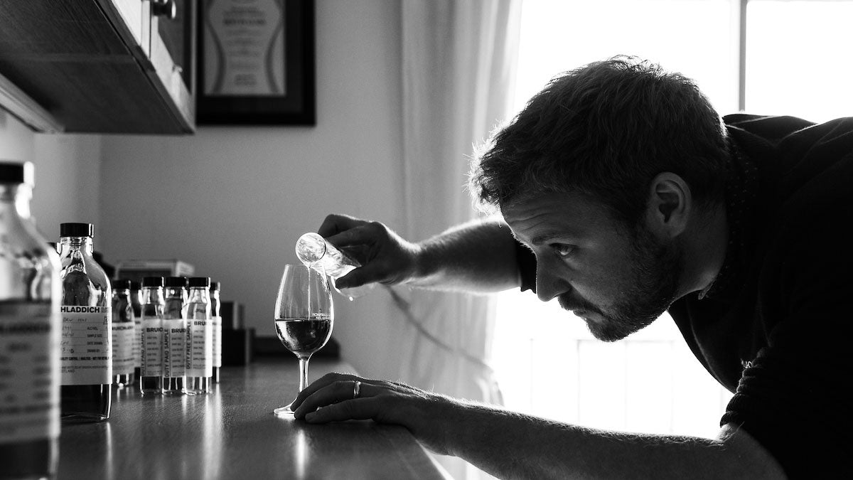 Adam Hannett of Bruichladdich distillery pouring whisky into a glass