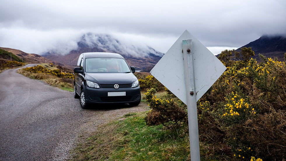 a car waiting in a passing place on a single track road in scotland