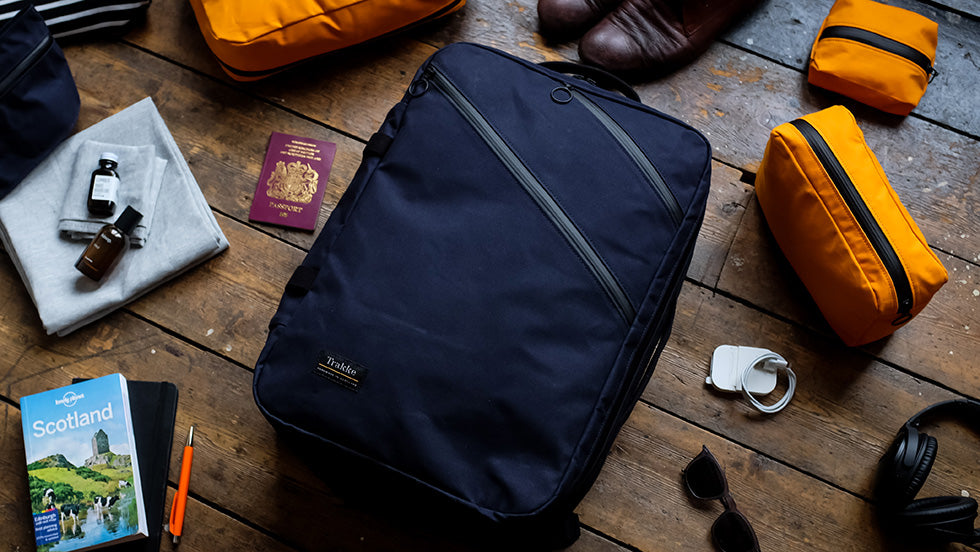 the storr carry on backpack in navy waxed canvas