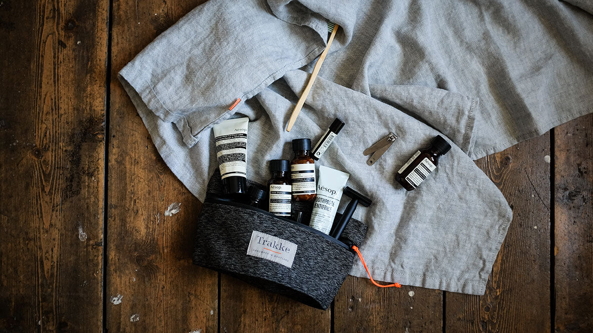 a dopp kit filled with travel toiletries