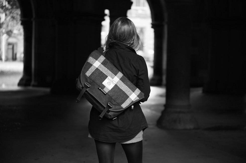 Mk1 Wee Lug Messenger Bag in Harris tweed worn by a women staring off into the distance