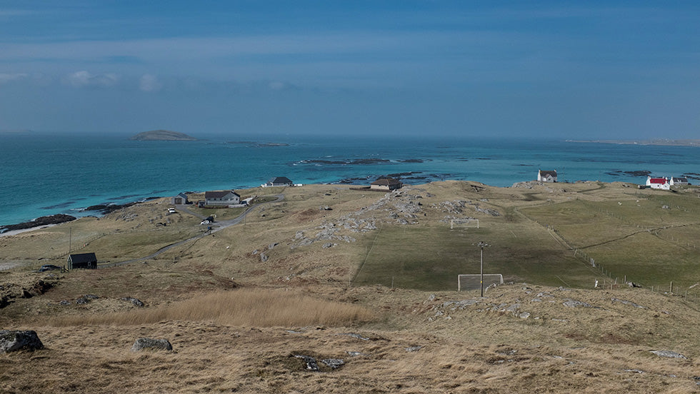 A photograph by Brian Sweeney showing the remote football pitch in Erisky with the sea as a backdrop