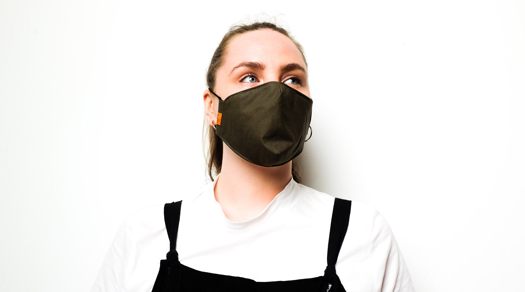 a woman wearing a reuseable cotton face mask
