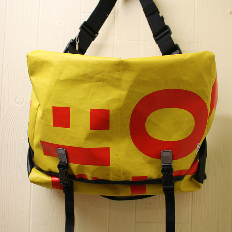 The very first Trakke bag made from recycled canvas is hung from a wall