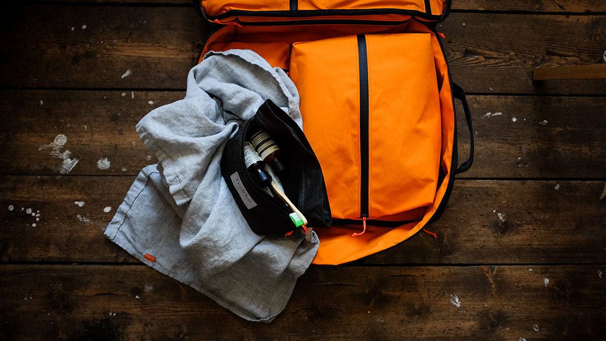 a dopp kit packed in a carry on backpack