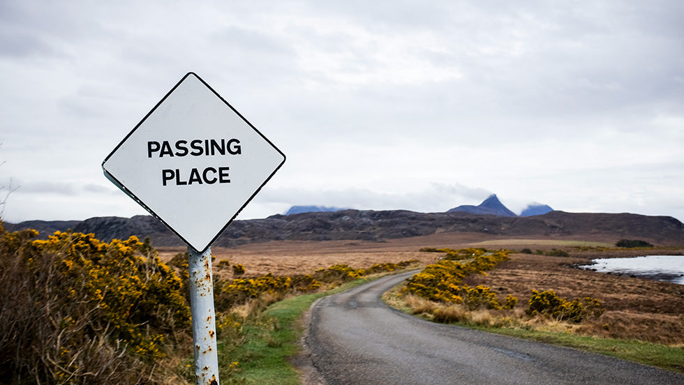a passing place sign on a single track road in scotland.