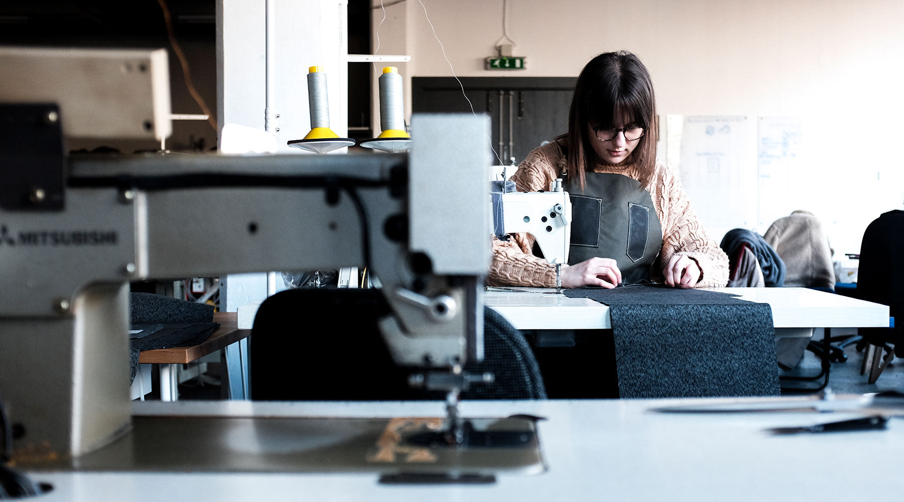 trakke machinist working on a bag at a sewing machine