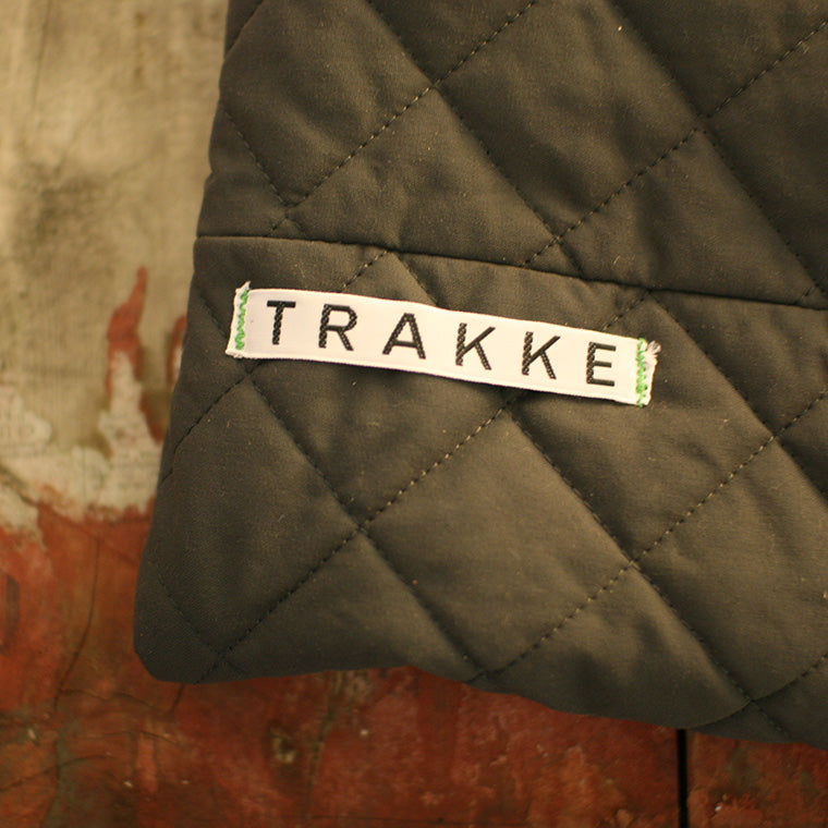 A very early Trakke label is sewed onto a piece of canvas