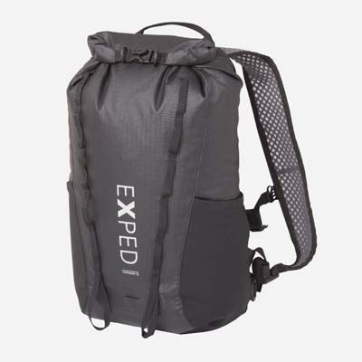 An all black roll top, waterproof backpack from Exped, on a white background.