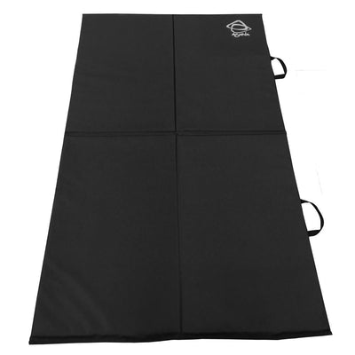 The inside of the Asana Pro Spotter pad. A black bouldering pad with a grey Asana logo printed in the top right corner with two black handles on a white background.