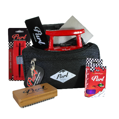 Ski and snowboard waxing kit. The kit includes a waxing iron, wax scraper, scraper sharpener, nylon brush, buffing pad, and all temperature 65g purl wax bar.