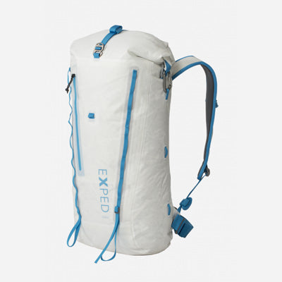 A white alpine climbing pack with light blue accents from Exped, on a white background.
