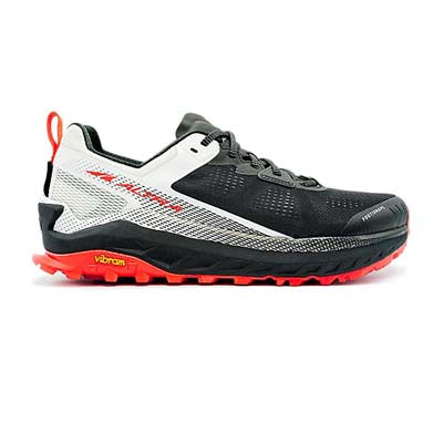 A black and white, low-top, lace-up, men's trail running shoe with a red sole, on a white background.