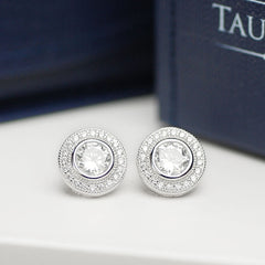 Luceat sterling silver halo studs with white cubic zirconias.