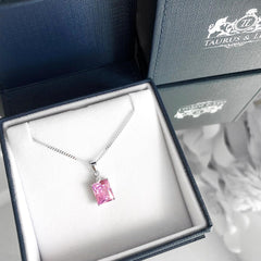 Justice sterling silver pendant with emerald cut pink cubic zirconia.