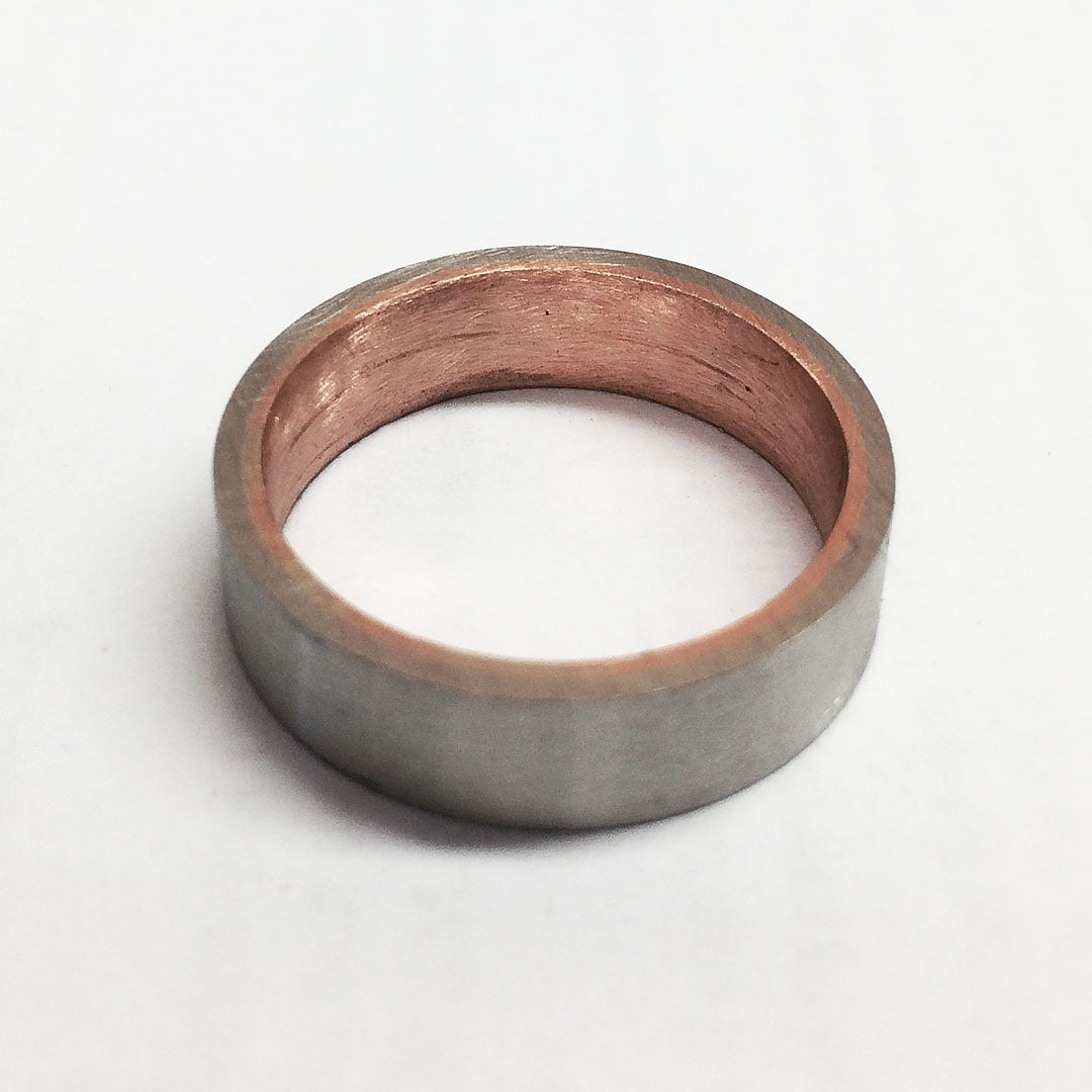 One two-tone 14k gold sleeved ring ready for finishing.