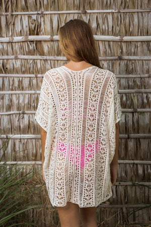 Beach Kaftan - Bohemian Romance White Wear the gentle touch of the sunset and let your soul dance to that Bohemian romantic rhythm at the beach inferno with our beach kaftan over swim
