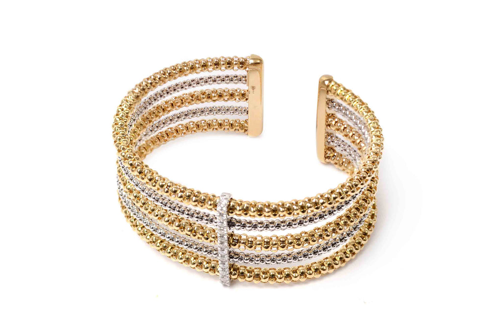 Brazalete CHimento (Italy) Stretch Colletion, oro 18K, y 0.42 ct en diamantes naturales.