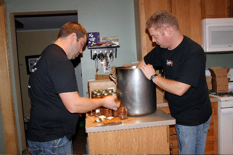Chris (left) & Ethan (right) packing up the original batch of West3 Spice Rub in Chris's kitchen outside Milwaukee Wisconsin