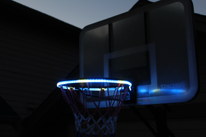 basketball rim is flashing blue and white with the HoopLight product