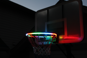 basketball rim is flashing multiple colors with the HoopLight product