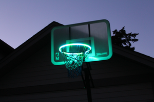 basketball rim is flashing teal with the HoopLight product
