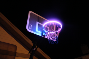 basketball rim is flashing purple with the HoopLight product