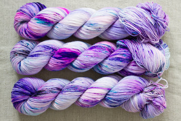 midnight pansies x pixie dust mashup - sock blend - 4ply fingering hand dyed yarn - 100g