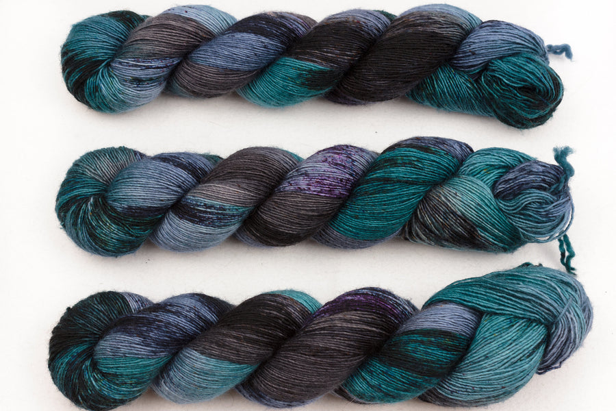 subterranean hand dyed yarn speckled yarn fingering yarn merino wool 4ply skinny singles dark green blue 100g