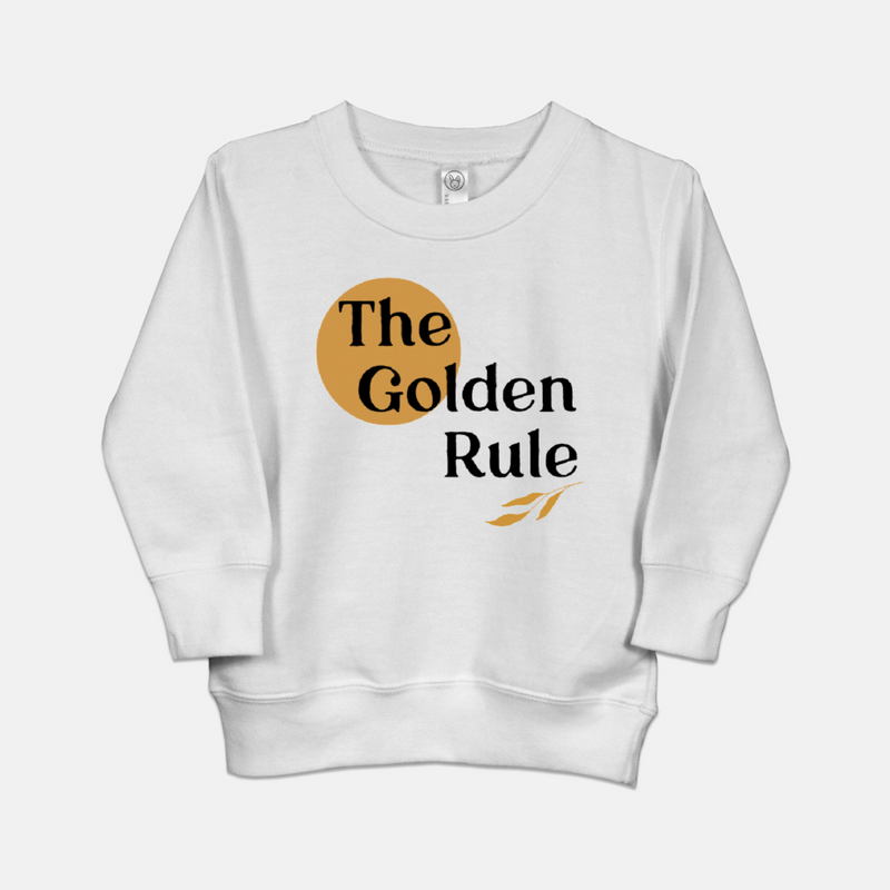 White toddler sweatshirt printed with a yellow sun, a sprig of three leaves, and the words The Golden Rule.