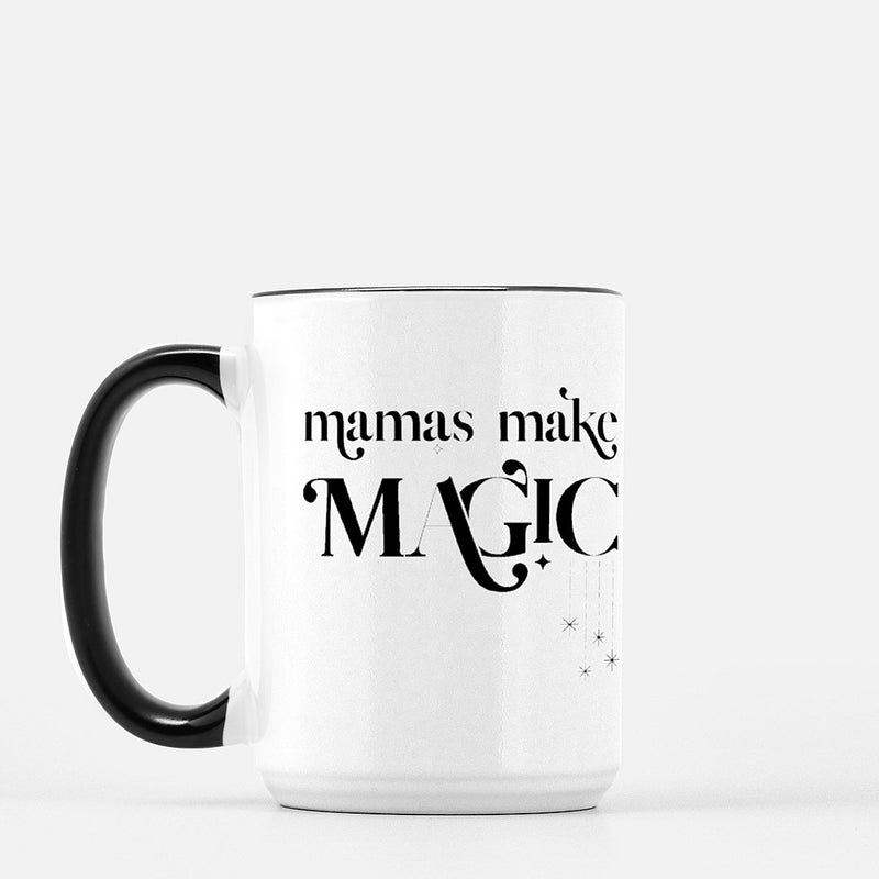 white coffee mug with a black handle printed with the words mamas make magic