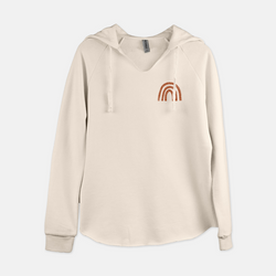 Women's pullover hooded sweatshirt printed with a small rust colored rainbow in the top right corner.