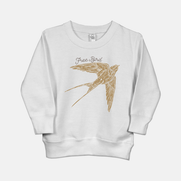 White toddler sweatshirt printed with a flying boho birdie and the words Free Bird.