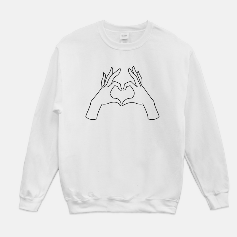White, adult sweatshirt printed with a line drawn illustration of two hands forming the shape of a heart.