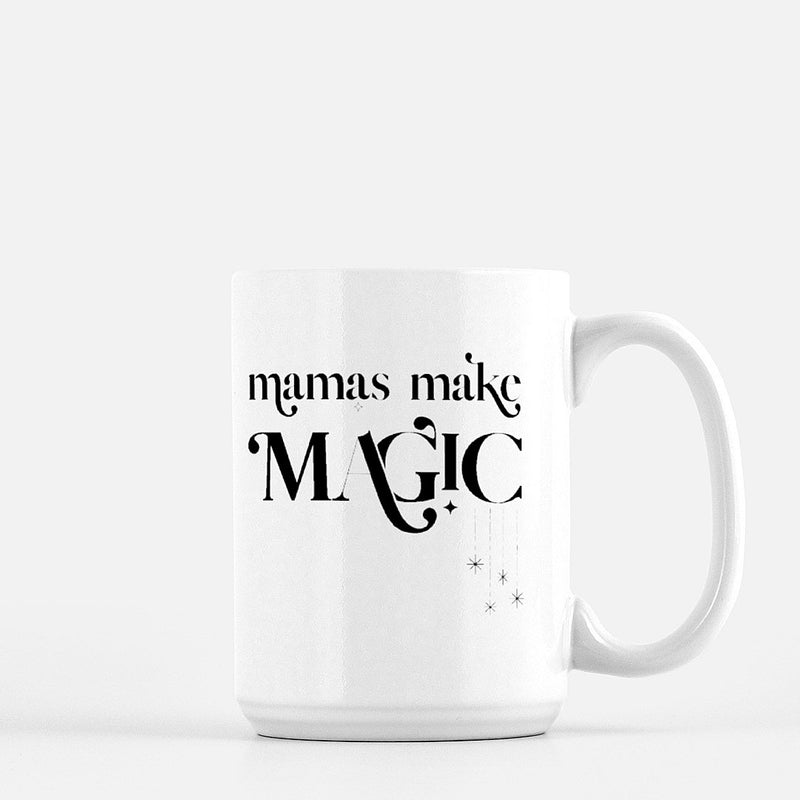 white coffee mug printed with the words mamas make magic