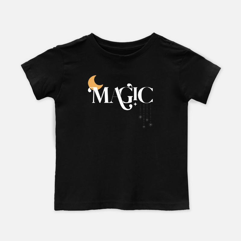black toddler tee shirt printed with the word magic and a yellow moon